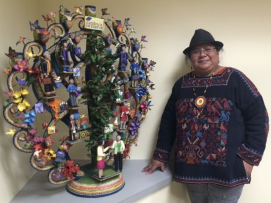 Artist Veronica Castillo with Excelencia Tree of Life